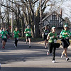 Record-Eagle/Keith King<br /> Runners near the finish line along Wadsworth Street Saturday, March 17, 2012 during the 2nd annual Leapin' Leprechaun 5k race in Traverse City.