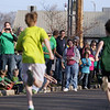 Record-Eagle/Keith King<br /> Spectators cheer and look on Saturday, March 17, 2012 as participants finish along Wadsworth Street during the 2nd annual Leapin' Leprechaun 5k Race.