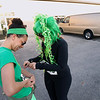 Record-Eagle/Keith King<br /> Angelina Baker, left, and Aly Jarosz, both of Traverse City, prepare for the 2nd annual Leapin' Leprechaun 5k race in Traverse City Saturday, March 17, 2012 which which started in Traverse City's Warehouse District.