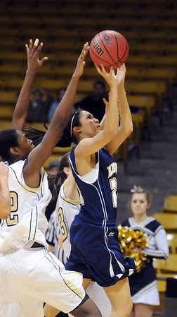 Legacy's Kailey Edwards goes to the basket past Monarch's Alexus Johnson during the Final Four 5A game at the Coors Event Center in Boulder on Wednesday <br /> <br /> <br /> March 10, 2010<br /> Staff photo/David R. Jennings