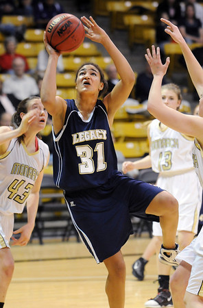 Legacy's Sade Akindele goes for two through Monarch players  during the Final Four 5A game at the Coors Event Center in Boulder on Wednesday <br /> <br /> <br /> March 10, 2010<br /> Staff photo/David R. Jennings