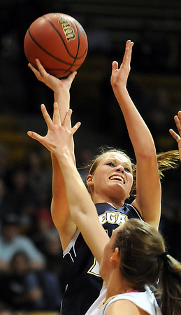 Legacy's Carli Moreland  goes for two against Monarch's Eliza   during the Final Four 5A game at the Coors Event Center in Boulder on Wednesday. <br /> <br /> <br /> March 10, 2010<br /> Staff photo/David R. Jennings