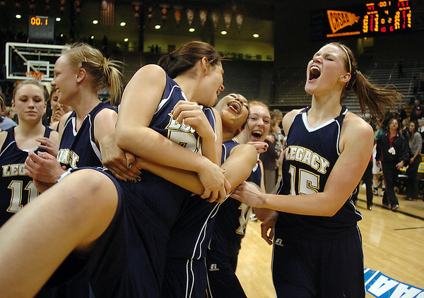 Legacy's Carli Moreland, right, celebrates with the team after the Lightning defeating Monarch 53 to 47 in the Final Four 5A game at the Coors Event Center in Boulder on Wednesday <br /> <br /> <br /> March 10, 2010<br /> Staff photo/David R. Jennings