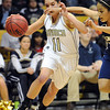 Monarch's Rebecca Richmond drives the ball against Legacy's Sarah Dunahay during the Final Four 5A game at the Coors Event Center in Boulder on Wednesday <br /> <br /> <br /> March 10, 2010<br /> Staff photo/David R. Jennings