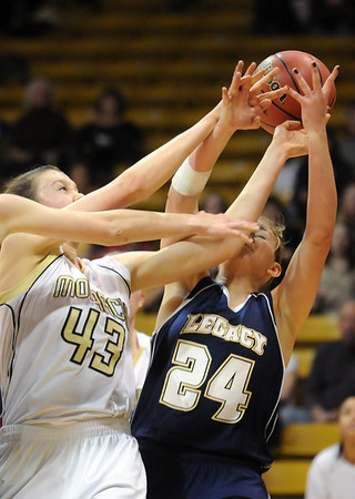 Legacy's Quincey Noonan collides with Monarch's Eliza Norman  during the Final Four 5A game at the Coors Event Center in Boulder on Wednesday <br /> <br /> <br /> March 10, 2010<br /> Staff photo/David R. Jennings