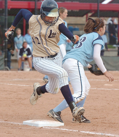 Rainey Gaffin, Legacy beats the ball to first base past Ralston Valley's Megan Eldredge during in the state 5A softball game, Saturday, at the Aurora Sports Park. <br /> October 24, 2009<br /> Staff photo/David R. Jennings