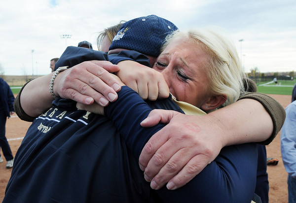 Legacy's Kaitlyn Mattila, with tears of joy is hugged by her parents after winning the state 5A softball championship against Ralston Valley  on Saturday at the Aurora Sports Park. <br /> <br /> October 24, 2009<br /> Staff photo/David R. Jennings