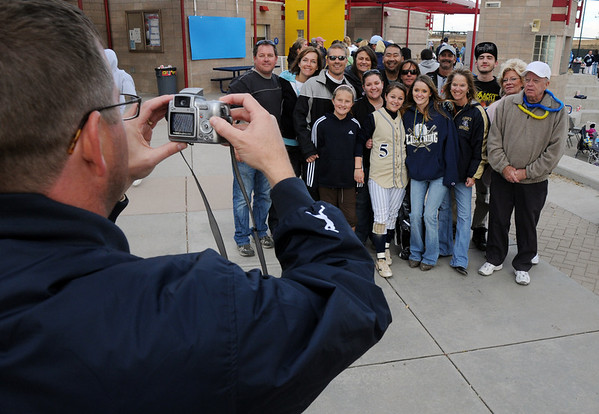 Legacy's athletic director Lee Peters, left, takes pictures of Payton Price with her family after winning the state 5A softball championship on Saturday at the Aurora Sports Park. <br /> October 24, 2009<br /> Staff photo/David R. Jennings