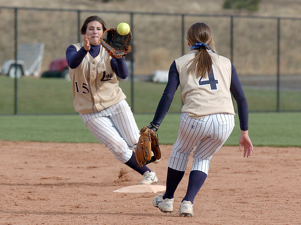 Legacy's Jessica Ball, left, catches a toss by Melissa Marcovecchio, for a double play in the state 5A softball championship game against Ralston Valley at the Aurora Sports Park. <br /> October 24, 2009<br /> Staff photo/David R. Jennings