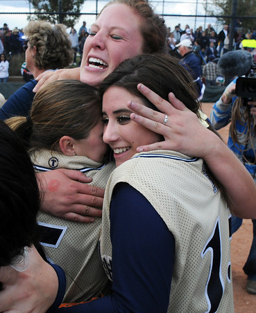 Shelby Babcock, center hugs teammates Payton Price, left, and Marisa Cordova after winning the state 5A softball championship against Ralston Valley, Saturday, at the Aurora Sports Park. This is the third state championship in a row for Legacy.<br /> <br /> October 24, 2009<br /> Staff photo/David R. Jennings