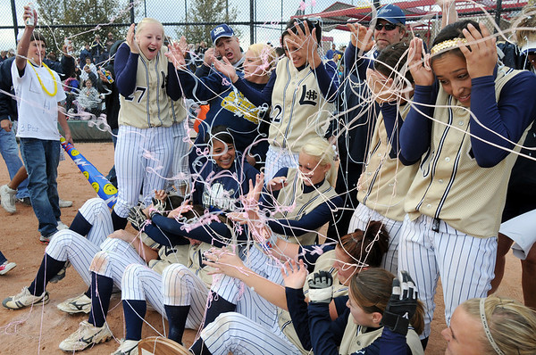 Fans spray the Legacy team with silly string after they won their third consecutive state 5A softball championship by defeating Ralston Valley 1-0 in 8 innings Saturday at the Aurora Sports Park.<br /> <br /> October 24, 2009<br /> Staff photo/David R. Jennings