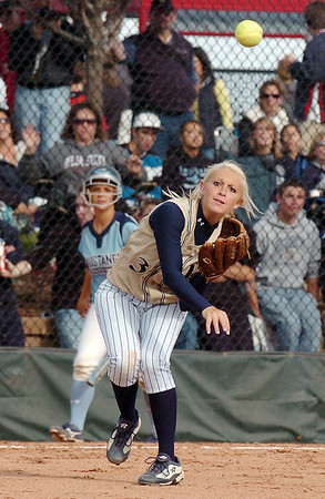 Legacy's Kaitlyn Mattila, throws the ball from third base to first during the state 5A softball game against Ralston Valley, Saturday, at the Aurora Sports Park. <br /> <br /> October 24, 2009<br /> Staff photo/David R. Jennings