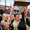 Legacy's Shelby Babcock holds up the state 5A softball trophy for the team to touch after their third state championship in a row by defeating Ralston Valley 1-0 in 8 innings Saturday at the Aurora Sports Park. <br /> <br /> October 24, 2009<br /> Staff photo/David R. Jennings