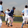 "Legacy High School's Will Peiker gets in a pickle with Ralston Valley's Anthony DiLoreto, No. 2, during a baseball game against Ralston Valley High School on Saturday, April 9, in Arvada. Legacy lost the game 13-12. For more photos go to  <a href=""http://www.dailycamera.com"">http://www.dailycamera.com</a><br /> Jeremy Papasso/ Camera"