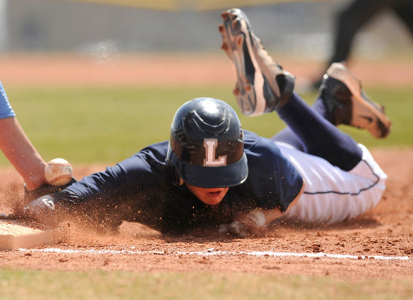 "Legacy High School's Tyler Clapper slides back into first-base after getting checked by the pitcher during a baseball game against Ralston Valley High School on Saturday, April 9, in Arvada. Legacy lost the game 13-12. For more photos go to  <a href=""http://www.dailycamera.com"">http://www.dailycamera.com</a><br /> Jeremy Papasso/ Camera"