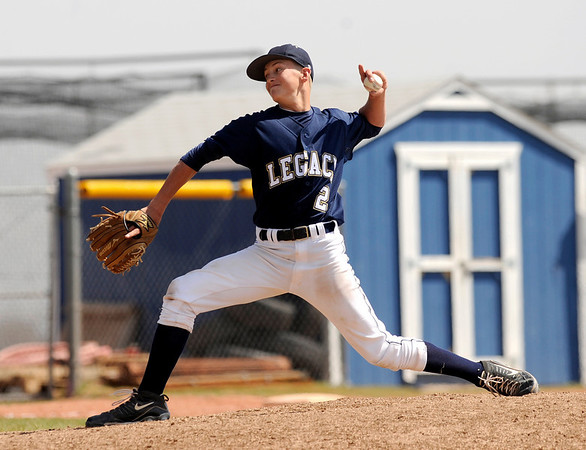 "Legacy High School pitcher Lucas Gibreth throws a curve ball during a baseball game against Ralston Valley High School on Saturday, April 9, in Arvada. Legacy lost the game 13-12. For more photos go to  <a href=""http://www.dailycamera.com"">http://www.dailycamera.com</a><br /> Jeremy Papasso/ Camera"