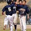 "Legacy High School's Dylan Farrel gets congratulated by Tyan Wessel, No. 7, and the rest of his team after hitting a home run in the second inning of the baseball game against Ralston Valley High School on Saturday, April 9, in Arvada. Legacy lost the game 13-12. For more photos go to  <a href=""http://www.dailycamera.com"">http://www.dailycamera.com</a><br /> Jeremy Papasso/ Camera"