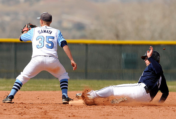 """Legacy High School's Jake Long slides under the tag of Ralston Valley's Jake Sawaya during a baseball game against Ralston Valley High School on Saturday, April 9, in Arvada. Legacy lost the game 13-12. For more photos go to  <a href=""""http://www.dailycamera.com"""">http://www.dailycamera.com</a><br /> Jeremy Papasso/ Camera"""