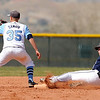 "Legacy High School's Jake Long slides under the tag of Ralston Valley's Jake Sawaya during a baseball game against Ralston Valley High School on Saturday, April 9, in Arvada. Legacy lost the game 13-12. For more photos go to  <a href=""http://www.dailycamera.com"">http://www.dailycamera.com</a><br /> Jeremy Papasso/ Camera"