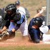 "Legacy High School's Tyler Clapper slides in safe at home plate under the tag of Ralston Valley catcher Danny Gibbs during a baseball game against Ralston Valley High School on Saturday, April 9, in Arvada. Legacy lost the game 13-12. For more photos go to  <a href=""http://www.dailycamera.com"">http://www.dailycamera.com</a><br /> Jeremy Papasso/ Camera"