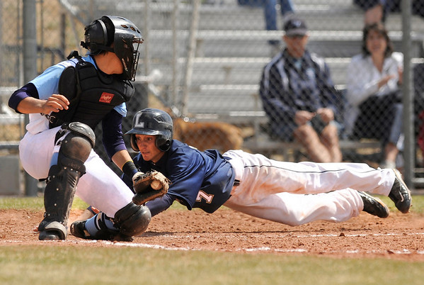 "Legacy High School's Ryan Wessel slides into home plate under the tag of Ralston Valley catcher Danny Gibbs during a baseball game against Ralston Valley High School on Saturday, April 9, in Arvada. Legacy lost the game 13-12. For more photos go to  <a href=""http://www.dailycamera.com"">http://www.dailycamera.com</a><br /> Jeremy Papasso/ Camera"