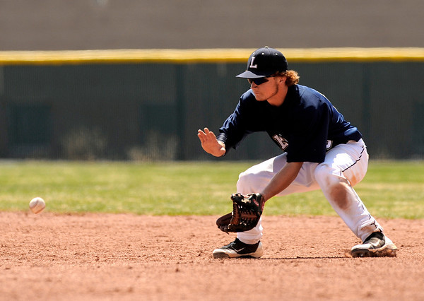 "Legacy High School's Joey Desimone stops a ground ball during a baseball game against Ralston Valley High School on Saturday, April 9, in Arvada. Legacy lost the game 13-12. For more photos go to  <a href=""http://www.dailycamera.com"">http://www.dailycamera.com</a><br /> Jeremy Papasso/ Camera"