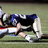 Legacy's Jordan King, (27) tackles Rocky Mountain's Ethan Farnsworth (80) during their game at Mountain Range stadium in Broomfield Friday, Sept. 18, 2009. <br /> <br />  DAILY CAMERA/ Kasia Broussalian