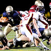 Legacy's Jake Levin , (11) attempts to carry the ball down field as Rocky Mountain defenders during their game at Mountain Range stadium in Broomfield Friday, Sept. 18, 2009. <br /> <br />  DAILY CAMERA/ Kasia Broussalian