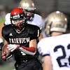Fairview's Cole Scheifele tries to avoid a tackle by Legacy's Drew Hebel during Saturday's game at Reicht Field.<br /> October 1, 2011<br /> staff photo/ David R. Jennings
