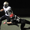 Legacy's Phydell Paris runs downfield as Fairview's Collin Brown makes the tackle attempt during Saturday's game at Reicht Field.<br /> October 1, 2011<br /> staff photo/ David R. Jennings