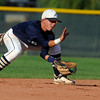 Legacy's Adrian Lomeli makes a play on a ground ball during a legion baseball game against  Gershkoff Auto Body's on Wednesday, July 11, at Legacy High School in Broomfield. <br /> Jeremy Papasso/ Boulder Daily Camera