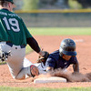 Legacy's Michael Miyasaki slides back safely to first base under the tag of Joe Nizolace during a legion baseball game against  Gershkoff Auto Body's on Wednesday, July 11, at Legacy High School in Broomfield. Jeremy Papasso/ Boulder Daily Camera