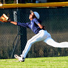 Legacy's Jared Crockett makes a diving catch in left field during a legion baseball game against  Gershkoff Auto Body's on Wednesday, July 11, at Legacy High School in Broomfield. <br /> Jeremy Papasso/ Boulder Daily Camera