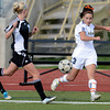 Legacy's Lauren Cook (right) kicks the ball past Mountain Range's Kacie McCleland (left) during their soccer game in Westminster, Colorado May 1, 2012. CAMERA/MARK LEFFINGWELL