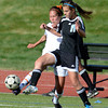 Legacy's Jasmine Beaulieu (left) competes with Mountain Range's Tina Kleidon (right) for the ball during their soccer game in Westminster, Colorado May 1, 2012. CAMERA/MARK LEFFINGWELL