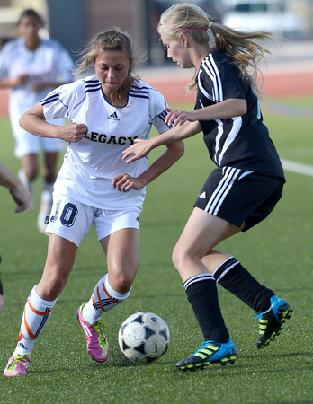 Legacy's Kelsey Killean (left) and Mountain Range's Laura Kutschmann (right) go for the ball during their soccer game in Westminster, Colorado May 1, 2012. CAMERA/MARK LEFFINGWELL