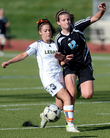 Legacy's Lauren Cook (left) collides with Mountain Range's Emma Hatfield (right) going for the ball 6during their soccer game in Westminster, Colorado May 1, 2012. CAMERA/MARK LEFFINGWELL
