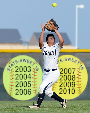 """Legacy High School's Jocelyn Howard makes a catch in the outfield during a softball game against Standley Lake High School on Thursday, Aug. 23, at Legacy High School. Legacy won the game 5-1. For more photos of the game go to  <a href=""""http://www.dailycamera.com"""">http://www.dailycamera.com</a><br /> Jeremy Papasso/ Camera"""