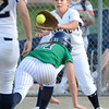 """Legacy High School pitcher Shania Leon tags out Rhiannon Parry at home plate during a pickle at a softball game against Standley Lake High School on Thursday, Aug. 23, at Legacy High School. Legacy won the game 5-1. For more photos of the game go to  <a href=""""http://www.dailycamera.com"""">http://www.dailycamera.com</a><br /> Jeremy Papasso/ Camera"""