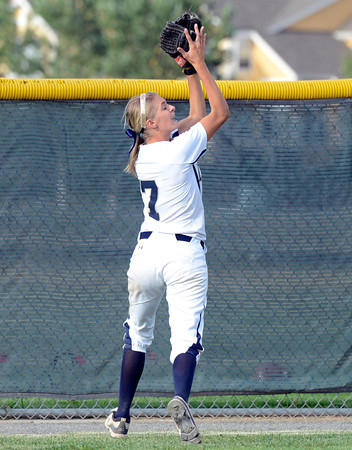 "Legacy High School's Bekka Prokaski makes a tough catch in the outfield during a softball game against Standley Lake High School on Thursday, Aug. 23, at Legacy High School. Legacy won the game 5-1. For more photos of the game go to  <a href=""http://www.dailycamera.com"">http://www.dailycamera.com</a><br /> Jeremy Papasso/ Camera"