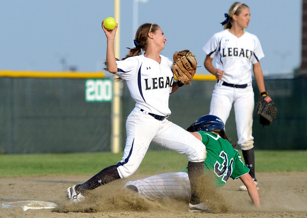 """Legacy High School's Paige Reichmuth makes an out on Rhianna May at second base during a softball game against Standley Lake High School on Thursday, Aug. 23, at Legacy High School. Legacy won the game 5-1. For more photos of the game go to  <a href=""""http://www.dailycamera.com"""">http://www.dailycamera.com</a><br /> Jeremy Papasso/ Camera"""