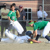 "Legacy High School's Angelique Archuleta, left, slides back to first safely under the tag of Brooke Stevens during a softball game against Standley Lake High School on Thursday, Aug. 23, at Legacy High School. Legacy won the game 5-1. For more photos of the game go to  <a href=""http://www.dailycamera.com"">http://www.dailycamera.com</a><br /> Jeremy Papasso/ Camera"