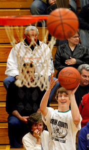 03/28/10 Winner of the three point shooting contest. Check this ??? James Van Horn of Columbia. Photo by Tom Mahl