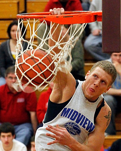 03/28/10 Midview's Nick Clark won the dunk contest. Photo by Tom Mahl