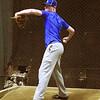 Pitcher Tyler Brandt warming up his arm