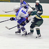 Leominster High School player Matt Williams and  Nashoba's Justin Livoli fight for control of the puck during their game on Monday. SENTINEL & ENTERPRISE/JOHN LOVE