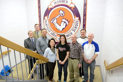 Danville High School senior signed a letter of intent to attend the University of South Carolina and play on the women's track and field team there. In the photo from left, Athletic Director Ron Kanaskie, Principal Lee Gump, Michael and Weifei Freedman, Shelby Freedman, Danville Track Coach Jeff Brandt, Danville Throwing Coach Jim Dressler, and Club Throwing Coach John Kotchmar.