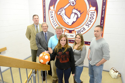 Danville High School senior Brittany Walters signed a letter of intent to attend Mansfield University and play soccer there. In the photo from left, Principal Lee Gump, Athletic Director Ron Kanaskie, Head Soccer Coach Tom Craig, Brittany Walters, and Angela and Bryan Walters.