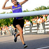 Boulder High School junior Kelsey Lakowske raises her hands in the air as she finishes first in the Girls 5A division of the Liberty Bell Cross Country meet at Heritage High School in Littleton, Friday, Sept. 18, 2009. <br /> <br />  DAILY CAMERA/ Kasia Broussalian