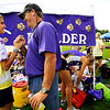 Boulder High School junior Kelsey Lakowske gets a pep talk from assistant cross country couch Carl Worthington before the Liberty Bell Cross Country meet at Heritage High School in Littleton, Friday, Sept. 18, 2009. <br /> <br />  DAILY CAMERA/ Kasia Broussalian